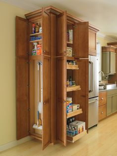 Thomasville Cabinetry's Utility Cabinets provide maximum organization in your home, allowing you to store anything from pantry items to cleaning supplies with ease.