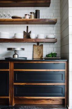 floating wooden shelves and matching cabinets add chic to the ktichen