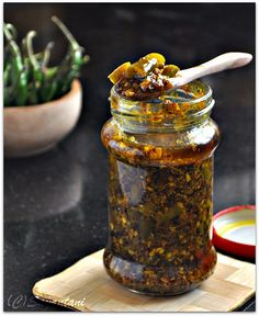 Indian style spicy fresh green chili pickle with spices and mustard oil.