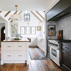 BECKI OWENS - Pinterest Top 10 - Visit the blog to see the top trending images on my boards this month! Like this kitchen I love with exposed beams and steel frame windows.