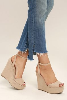 "All your other shoes are ""nada"" when compared to the Nahele Nude Suede Ankle Strap Wedges! Nude suede covers these cute wedge with a peep-toe, 1.5"" toe platform, and adjustable ankle strap (with gold buckle)."