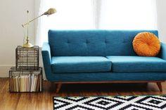 a beautiful mess living room blue sofa orange pillow Home Living Room, Living Room Decor, Ikea Rug, Couch Furniture, Plywood Furniture, Modern Furniture, Furniture Design, Def Not, Contemporary Sofa