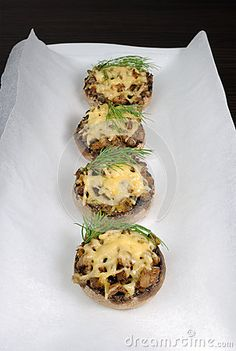 Champignons with vegetable stuffing and cheese