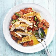 Fennel-crumbed chicken, tomato and basil salad, a delicious recipe from the new Cook with M&S app.