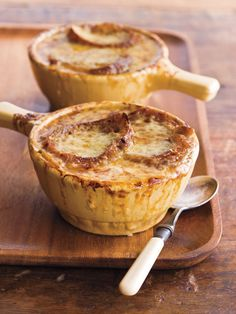 French Onion Soup ****2 Tbs. unsalted butter  2 1/2 lbs. yellow onions, halved and thinly sliced  1 Tbs. all-purpose flour  1 cup dry white wine  8 cups beef stock  2 tsp. minced fresh thyme, or 1 tsp. dried  1 bay leaf  Kosher salt and freshly ground pepper  1 crusty baguette  2 2/3 cups shredded Gruyère cheese