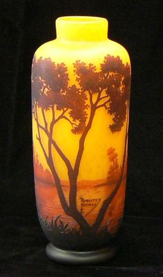 Amber and yellow tree cameo glass vase.