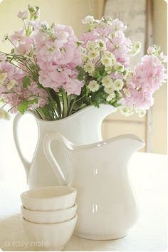 Simple white pitchers....Old-Fashioned Flowers