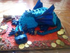 Magic Treasure Dragon Cake: This dragon cake was made with dark chocolate mud and white chocolate cakes.  I used a Dolly varden tin for the front of its body and I used a 13 inch
