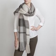 Hand woven with 3 complex 24 shaft weave structures Araminta combined different tones of the white, grey and black fleece. The contrast between the structures creates wonderful textures and drape of the heavy alpaca fibre the scarf puts the finishing …
