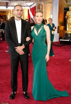Cute couple: Scarlett is married to French journalist Romain Dauriac...