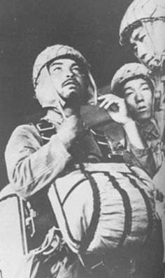 commander of the 2nd Raiding Brigade Rikichi Tsukada adjusting his helmet, Some 750 men, mainly from the 2nd Raiding Brigade, of this group were assigned to attack American air bases on Luzon and Leyte on the night of 6 December 1944. They were flown in Ki-57 transports, but many of the aircraft were shot down. Some 300 commandos managed to land in the Burauen area on Leyte. The force destroyed dozens of planes and inflicted numerous casualties