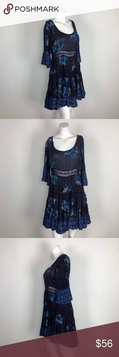 "Free People Voile Lace Purple Floral Dress Tiered CONDITION: Missing size tag but measures closest to a Medium - please check measurements below to determine fit.  DETAILS: This is a fun 3/4 sleeved dress from Free People. Dark purple with blue floral print. Lace cut-out details in tiered layers. High-low styling.  Bust: 19.5"" Waist: 15.5"" Length: 33"" front / 37"" back Free People Dresses"