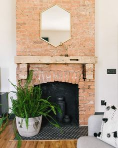 What do YOU do with your fireplace in the summer? Our friends over at styled the interior of this one with monochromatic terracotta vases! Exposed Brick Fireplaces, Brick Fireplace Wall, Exposed Brick Walls, Living Room With Fireplace, Metal Walls, Fireplace Ideas, Cottage Fireplace, Stove Fireplace, Log Burner Living Room