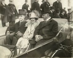 Sepia toned photograph of President Calvin Coolidge, Mrs. Coolidge and Senator Curtis on the way to the Capitol as they sit in a convertible automobile, March President Calvin Coolidge, Mrs. Coolidge and Charles Curtis. This image is available as a print. Black Presidents, American Presidents, American History, Republican Presidents, Charles Curtis, Calvin Coolidge, Presidential Inauguration, Presidential History, American First Ladies