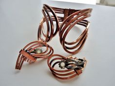 Vintage Renoir Copper Modernist Clamper Hinged Cuff Bracelet Matching Cushion Clip on Earrings Set . Spring Hinged Clamper Cuff Bracelet. Established 1946, RENOIR of California produced copper jewelry until 1964 .