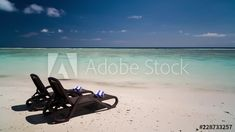 Stock Footage of Luxury beach chairs and towels on tropical island, white sandy beach on sunny day at private holiday/honeymoon resort, scattered clouds. Timelapse Explore similar videos at Adobe Stock Beach Chairs, High Quality Images, Sunny Days, Stock Footage, Tropical, Clouds, Island, Luxury, Holiday