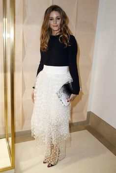 A plain black top instantly becomes elegant when paired with a pretty, white tulle skirt like this one. #Olivia Palermo #Fashion