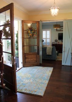 San Marco home with double door entry and sliding barn doors