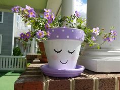 Clay pot. Purple polka dotted paint :) Flower Pot Art, Flower Pot Design, Clay Flower Pots, Flower Pot Crafts, Flower Planters, Flower Pot People, Clay Pot People, Clay Pot Projects, Clay Pot Crafts