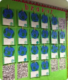Earth day project. Each student makes an Earth with their handprint and writes their Earth day promise. Super cute!