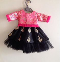 A truly royal outfit fit for a princess, with a stunning brocade top and raw silk skirt. The skirt has embroidered floral motifs all over. The sleeve and hems of the outfit have ruffle tulle edges giving a fairy tale vibe to the dress. Available in custom colors. Please convo me the color