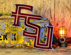 Florida State University FSU Letters Florida State University, Florida State Seminoles, Universities In Florida, Team Mascots, Garnet And Gold, Metal Artwork, Hanging Pictures, Paint Finishes, Vintage Metal