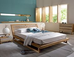 Slanted Headboard- Awesome bed! http://interiorideaz.com/design/wp-content/uploads/2012/04/indonesian-bedroom-1-554x425.jpg