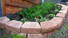 Raised Flower Beds from Recycled Materials - http://www.greenerideal.com/lifestyle/0528-raised-flower-beds-from-recycled-materials/