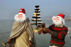 """""""Indian devotees dressed as Santa Claus pray at Sangam, confluence of three rivers, the Ganga, the Yamuna and mythical Saraswati on the eve of Christmas festival in Allahabad, India. Picture: AP"""""""