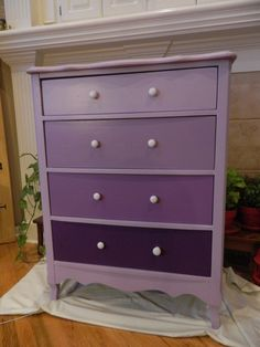 Purple painted dresser I'm so doing this in pink purple and yellow for the girls dressers!!