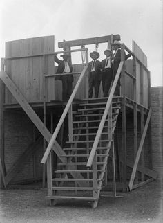 Unidentified men wait at the gallows prior to the hanging of Melquiades Chapa and Jose Buenrostro Brownsville Texas May 19th 1916 [714 977]
