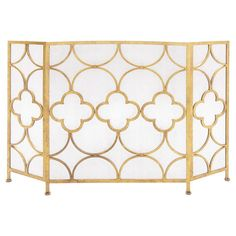 A luxe addition to your living room or den, this metal fireplace screen showcases a yellow finish and quatrefoil trellis design. Pr...