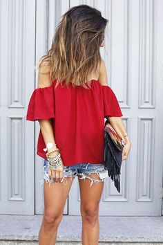 Red off the shoulder blouse.