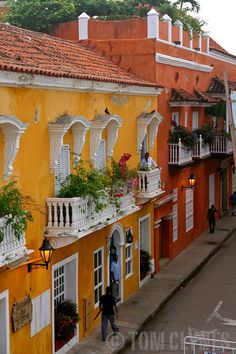 Vibrantly colorful houses line the streets of the Old Town in Cartagena, Colombia Honduras, Colourful Buildings, Colorful Houses, Beautiful World, Beautiful Places, Ecuador, Travel Around The World, Around The Worlds, Costa Rica