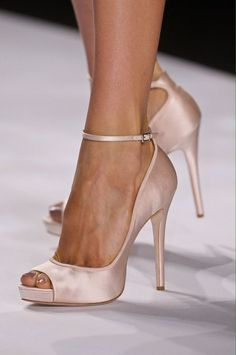 Simple, satin, nude ankle strap heels.