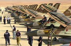 Israeli F-16s, probably abroad, since in Israel planes are mostly kept in single shelters
