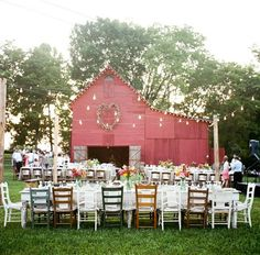 this is magic. long tables. mismatched chairs. twinkle lights. barn. so lovely.