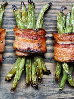 Green bean bacon bundles. Get this and more tasty green bean recipes that are perfect for the holidays. #greenbeans #greenbeanrecipes #recipes #thanksgiving #thanksgivingsides #thanksgivingrecipes #recipes