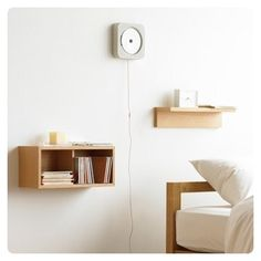 take ikea wooden boxes and mount to wall for bedside tables?