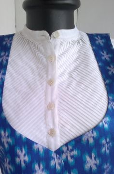 White handwoven fine cotton , pleated perfectly to create a kurti.This kurti comes along with a handwoven silk ikat jacket.This is a combination that will make to stand apart in a crowd. Salwar Neck Designs, Neck Designs For Suits, Kurta Neck Design, Kurta Designs, Blouse Designs, Sleeve Designs, Kurta Patterns, Neck Patterns For Kurtis, Dress Patterns