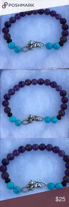 """Amethyst Turquoise Magnesite Kitty Cat Bracelet This beautiful bracelet is made with natural amethyst and magnesite. It features a silver tone cat connector. This piece is on elastic and will stretch to fit up to an 8"""" wrist.   All PeaceFrog jewelry items are handmade by me! Take a look through my boutique for more unique creations. PeaceFrog Jewelry Bracelets"""