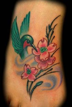 Google Image Result for http://zhippo.com/TattooInspirationHOSTED/images/news/bird-flower-foot-tattoo.jpg