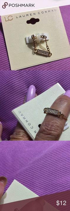 NWT LAUREN CONRAD RING NWT Lauren Conrad delicate chain ring. Goldtone chain links attached  to a rectangular bar. One side with with pave crystals and other side is plain gold tone. Size tag is missing but is a size 7. LC Lauren Conrad Jewelry Rings