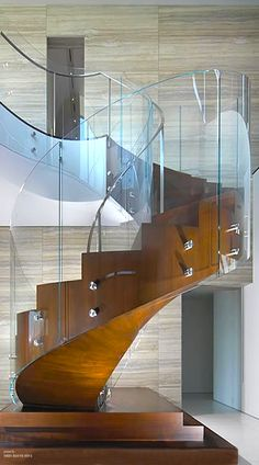 Contemporary glass panel spiral staircase
