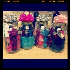 Mason Jar Christmas gifts: fuzzy socks, nail polish, manicure sets, lip gloss & body spray. Topped off with a gift bow.