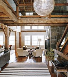 This old barn was taken from Canada to Connecticut and was converted into a home. Russel Groves is one of the architects that worked to bring to life this project.