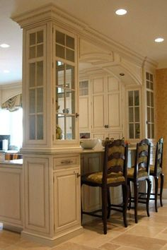 Love the lites in these painted traditional cabinets.
