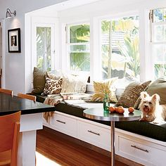 a wide, built-in day bed serves as a window seat for the pets to relax while it adds extra seating in the kitchen for large family gatherings  #design #interior #inspiration #interior_design