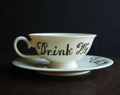 Alice's Teacup...could probably make these with a sharpie and inexpensive cups from the dollar store/Walmart