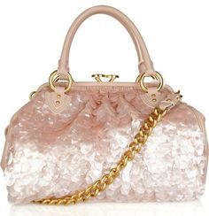 Marc Jacobs Delray Pailette-Embellished Bag  a large shoulder bag made of blush leather covered front and back (the sides are left exposed leather) with perfectly matched oval-shaped pailettes. It has double rolled leather top handles and a heavy golden chain shoulder strap, plus the top closes via a darling push-clasp fastener with a designer stamp. Other features include protective metal feet and an interior fully lined in tan satin with one zippered pocket. Gorgeous. $2,350